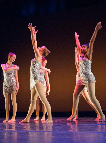 Female dancers performing on stage