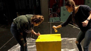Students painting a stage set