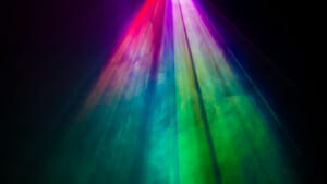 Colorful stage lights shining down on a stage