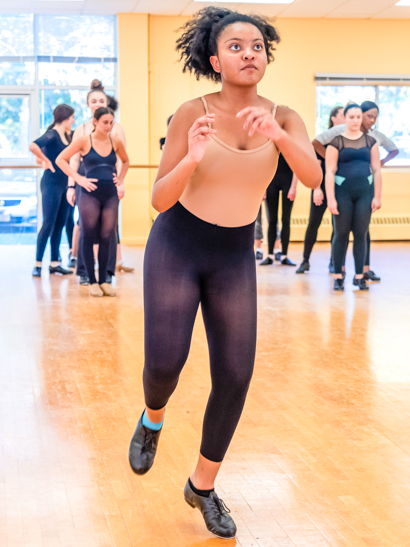 Female student tapping in dance class