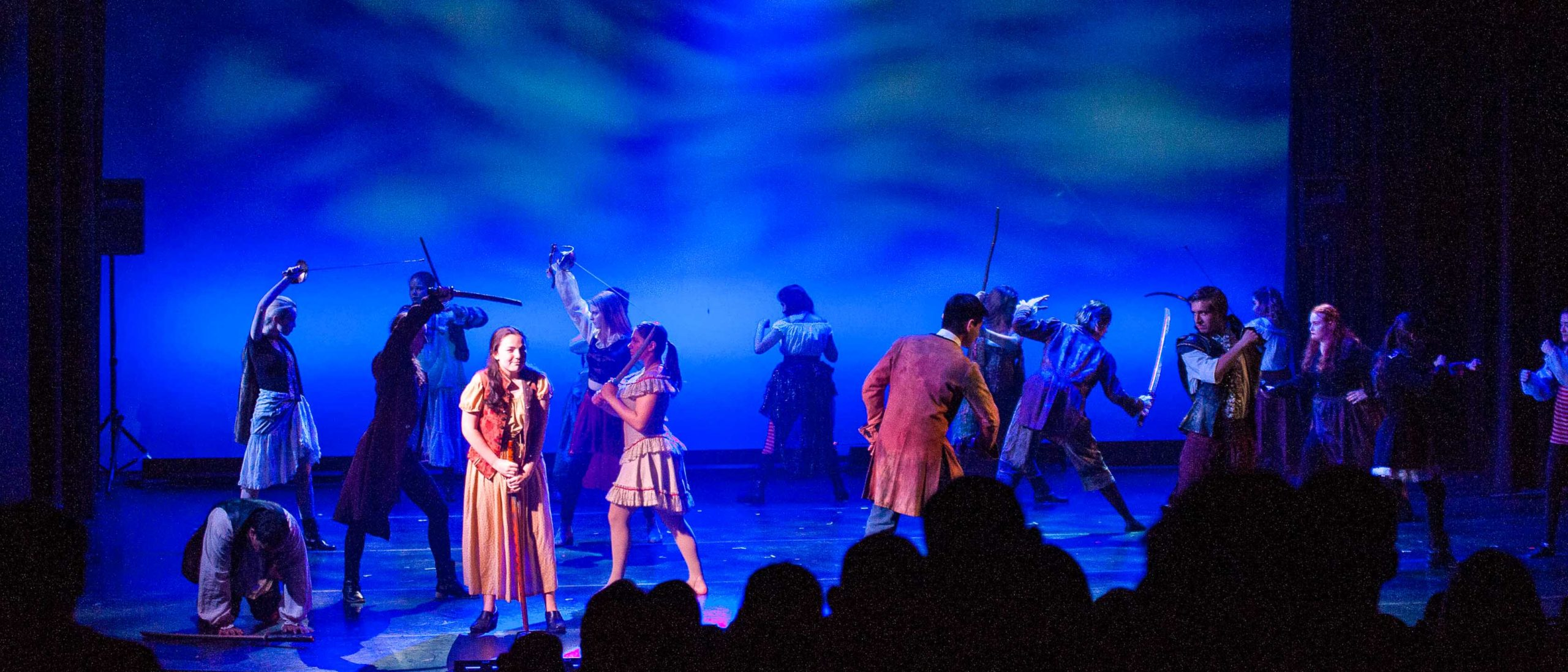 Students dancing with swords during a performance