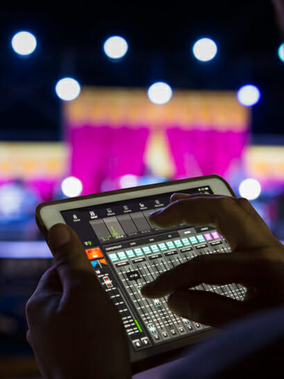 Someone controlling lights via an ipad for the stage