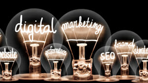 Lightbulbs with the filaments selling out words such as digital marketing