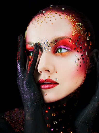 Woman with costume makeup on a jewels on her face