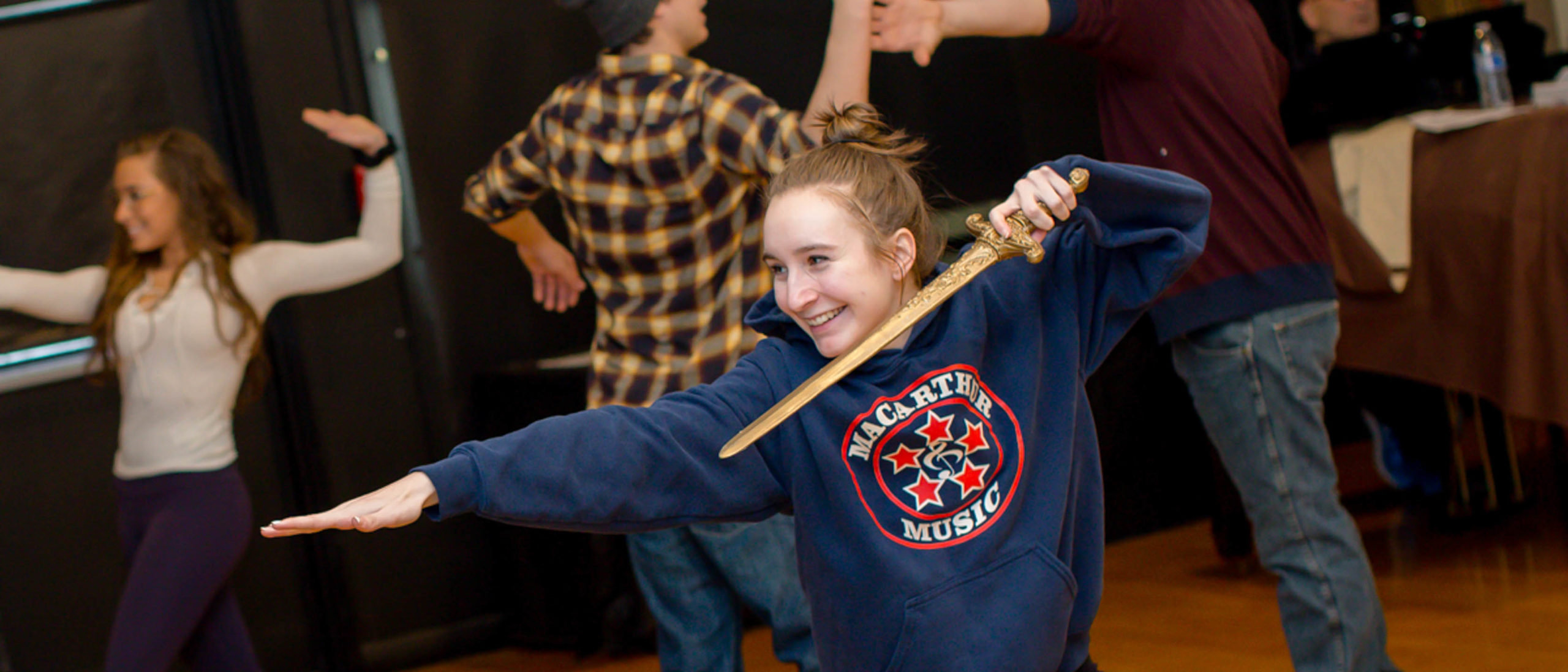 Students learning how to sword fight