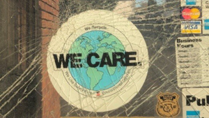 We Care sticker on a smashed piece of glass