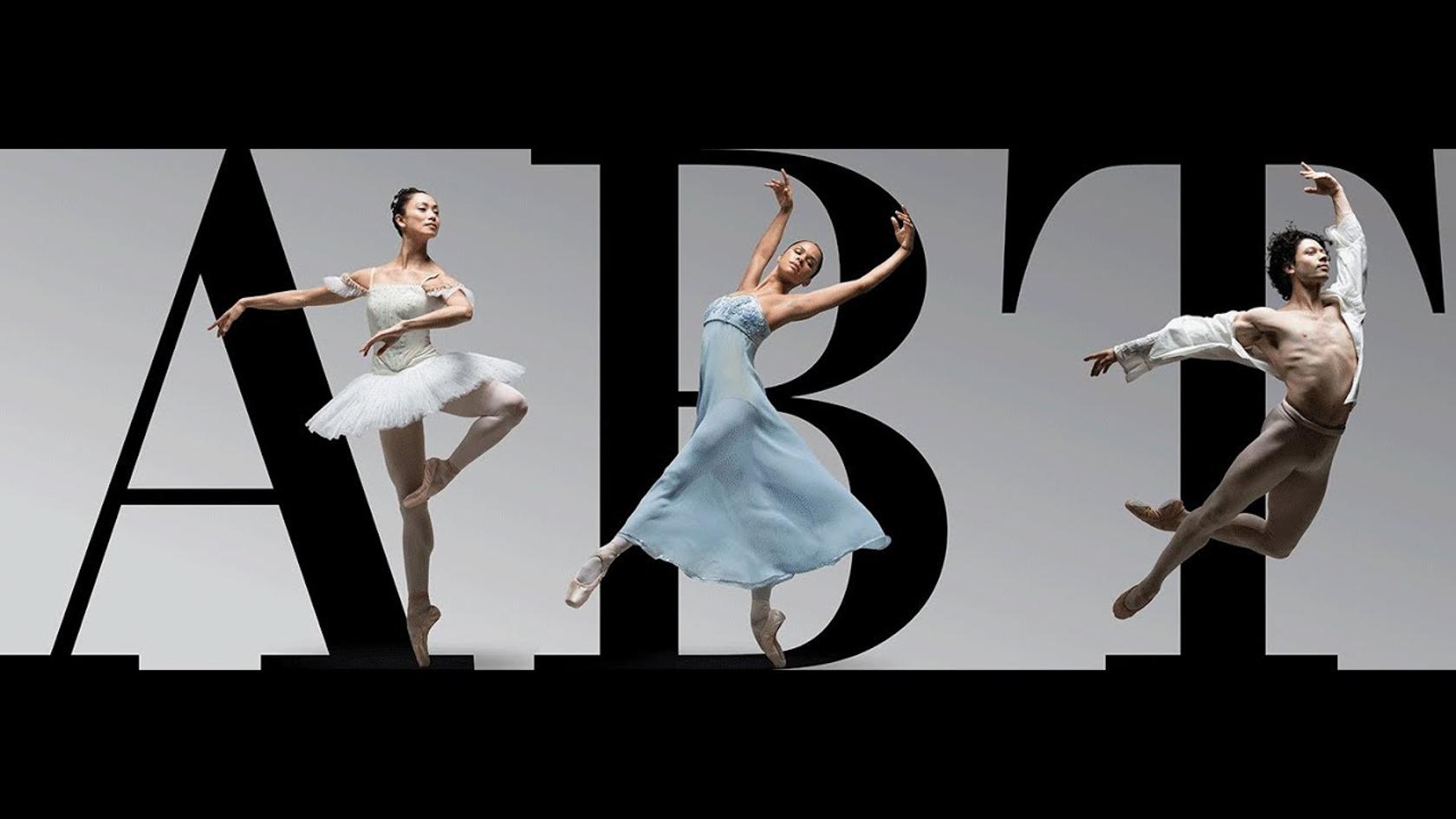 Ballet dancers dancing in front of the American Ballet Theatre logo