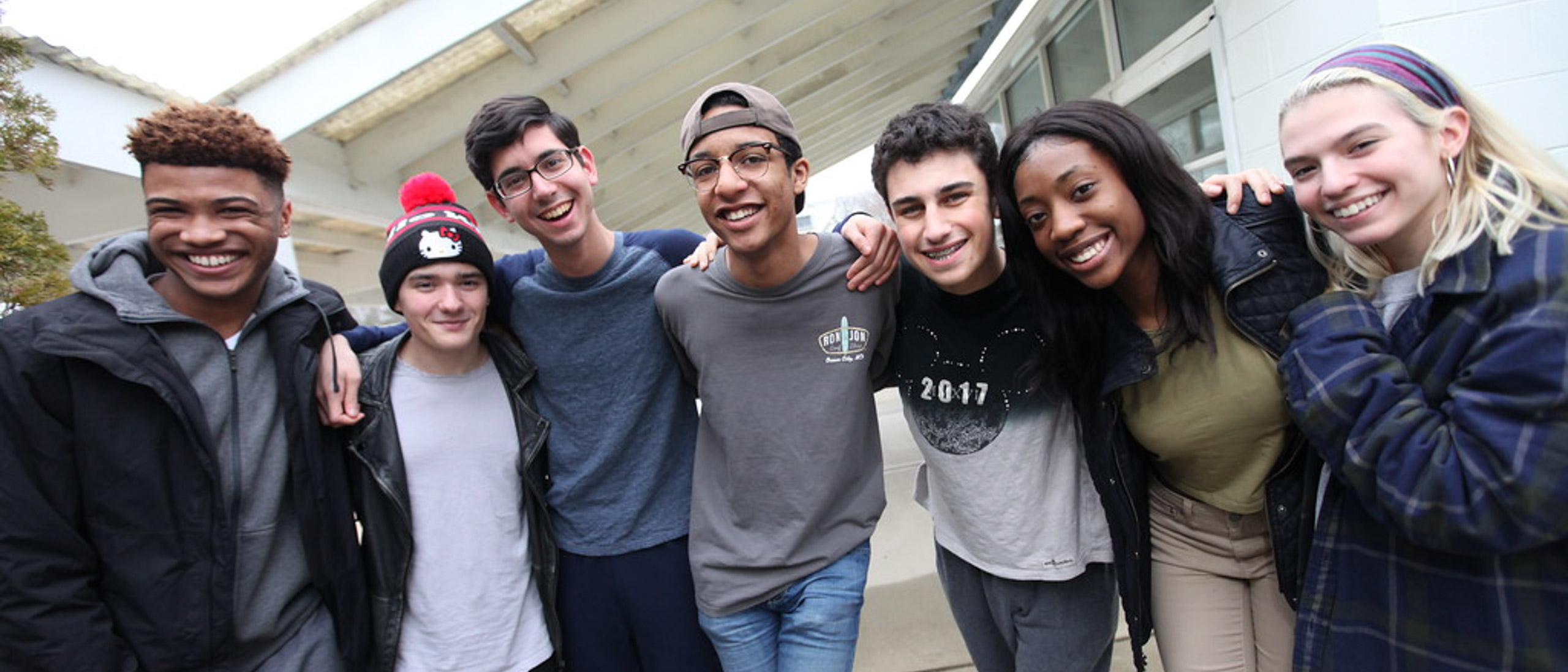 Group of students smiling and laughing together