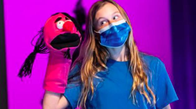 girl doing puppet show